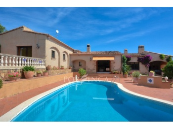 Rustic style house built in Catalan style with several cosy terraces, covered summer kitchen close to the pool; high level of privacy.